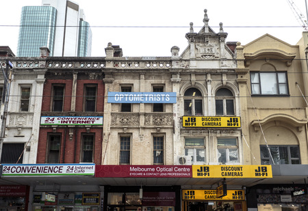 Old buildings from the end of the nineteenth century with retail shops in central downtown Melbourne, Australia Editorial