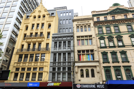 Old buildings from the twentieth century with retail shops in central downtown Melbourne, Australia