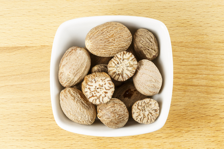 Nutmeg is the spice made from the seed of the fragrant nutmeg tree, Myristica fragrans, native to Banda Islands in the Moluccas (Spice Islands) of Indonesia Stock Photo