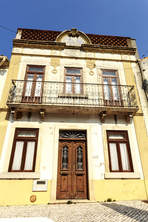 Classic architecture of an old building in apparent bad state of conservation in Vila de Rei, Portugal