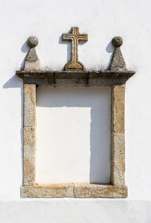 Detail of a possible small altar on the facade of the 15th century Parish Church of St Peter in Sertã, Portugal