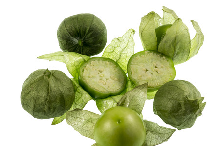 The Tomatillo or Mexican Husk Tomato, Physalis philadelphica, originated in Mexico and are a staple of Mexican cuisine, eaten raw or cooked, particularly in salsa verde Stock Photo