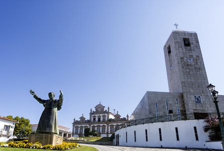 View of the City Hall building, the Parish Church of Our Lady of Incarnation and the statue to Pope John Paul II, in Mirandela, Tras os Montes, Portugal