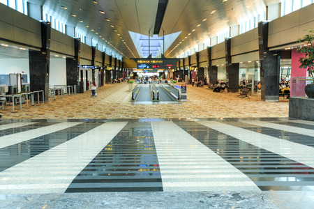 View of the very long hallways and travelators of Changi Airport in Singapore, South East Asia