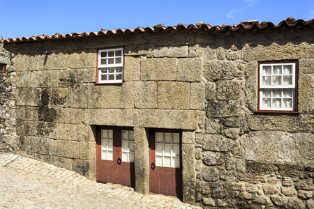 View of the traditional houses built in the locally abundant granite stone, in the medieval village of Sortelha, Portugal