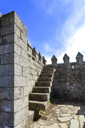View of the steps to the ramparts and battlements surrounding the castle of Sabugal, Portugal