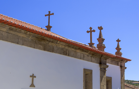 Detailed view of the crosses of the parish church of the village of Castelo Melhor, Portugal
