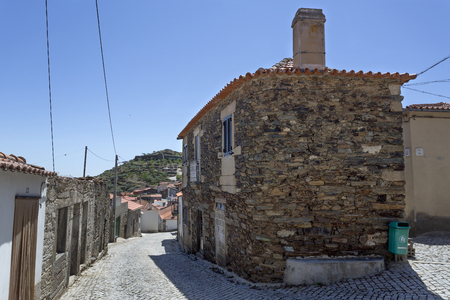 View of a traditional schist and granite house right in the middle of the medieval village of Castelo Melhor, Portugal,