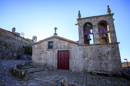 View of the Romanesque Church of Our Lady of Rocamador and the Clock Tower of the historic village of Castelo Rodrigo, Portugal