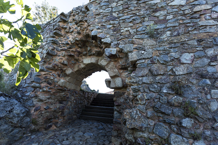 Ruins of the St John Gate with a rounded vault and full arch, built on the barbican of the citadel of Castelo Rodrigo, Portugal Stock Photo