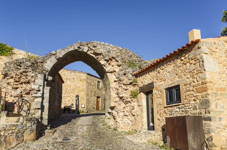 Facing east towards Spain, the Sun Gate (Porta do Sol), with its ogival arch, is one of the three entrances of the historical village of Castelo Rodrigo, Northern Portugal