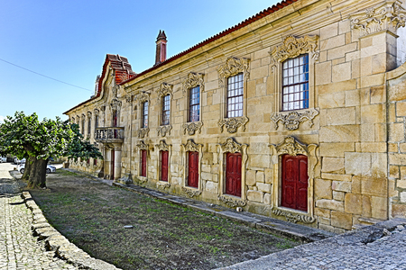 HDR View of the austere baroque Manor of the Viscount of Almendra, with rocaille windows, traditional inverted scallops and balcony with balusters. 版權商用圖片