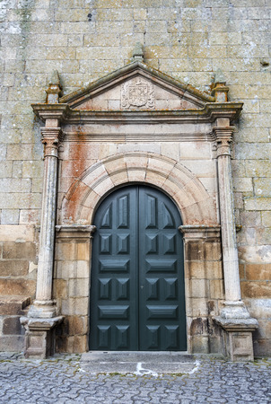 View of the portico of the cemetery side facade of the parish church, in the historic village of Escalhao, Portugal