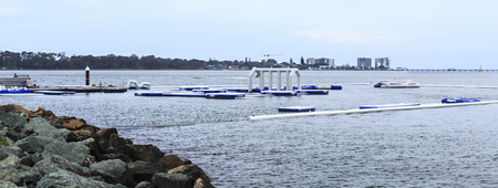 View of the inflatable water fun park, called AquaSplash Redcliffe, being constructed on the shores of Pelican Park in the Redcliffe Peninsula, Queensland, Australia Stock Photo
