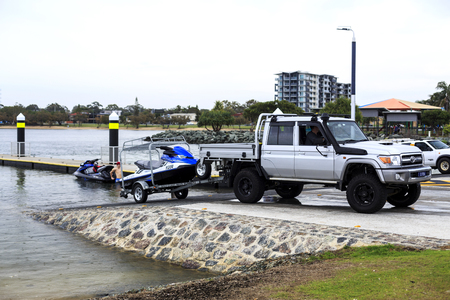 Prepare to launch a jet ski watercraft at the boat ramp in the Redcliffe Peninsula, Queensland, Australia