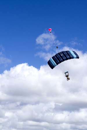 Tandem skydive is the awesome rush of exhilarating freefall after leaping out of a plane to land on the beach, in Queensland, Australia