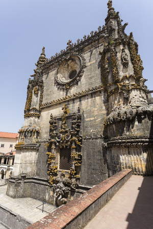 Image of the elaborated western facade of the late gothic church at the Convent of Christ, an UNESCO monument in Tomar, Portugal Stock Photo