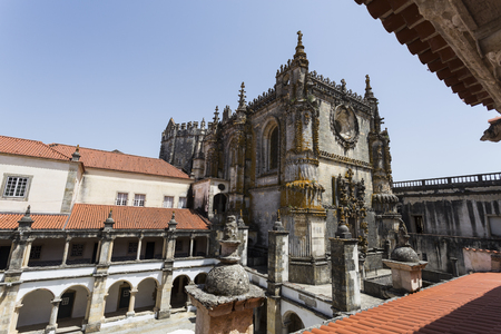 The Hostelry Cloister and the Manueline nave of the church seen from the cells of the Grand Dormitory in the Convent of Christ, Tomar, Portugal