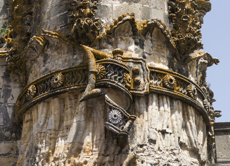 Detail of the carvings, belt and statues, of the facade of the late gothic church at the Convent of Christ, an UNESCO monument in Tomar, Portugal