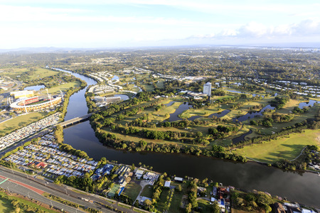Panoramic view of a total 27 hole golf course seen from a hot air balloon flight at sunrise, in the Gold Coast, Queensland, Australia