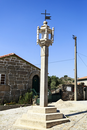 View of the 16th century granite cage pillory, totally rebuilt in the 21st century, facing the local medieval jail in the village of Mesquitela, Guarda, Portugal