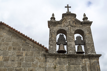 Detail of the belfray of the 17th century Church of Mercy, built of local granite stone, in Linhares da Beira, Gouveia, Portugal Stock Photo