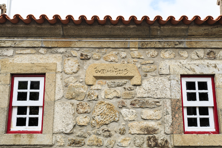 Inscription of unknown origin and meaning on the lateral facade of the chapel of Our Lord of the Steps, today the Tourism Office of the historic village of Linhares da Beira, Gouveia, Portugal