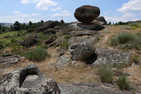 Panoramic view of some of the fifty-four sepultures, or burial sites, surrounding the mythical Bell Stone of the Necropolis site of St Gens near Celorico da Beira, Beira Alta, Portugal