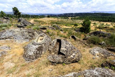 View of a pair of granite rock cut non-anthropomorphic graves at the St Gens Necropolis Site near Celorico da Beira, Beira Alta, Portugal Stock fotó