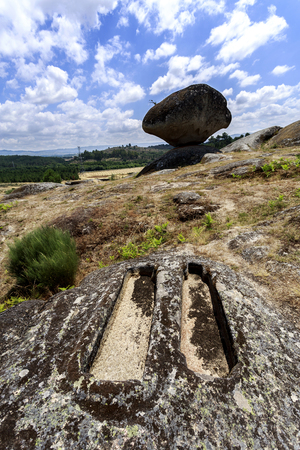 View of a pair of granite rock cut anthropomorphic grave, body-shaped form with head and/or feet defined, at the St Gens Necropolis Site near Celorico da Beira, Beira Alta, Portugal