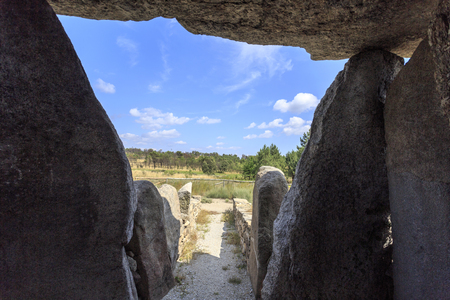 View from inside the Dolmen of Cortico, towards the dolmen corridor, in Fornos de Algodres, Portugal Фото со стока