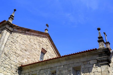 Crosses and pinnacles of the St Peter Church in Castro Daire, Portugal Stock Photo