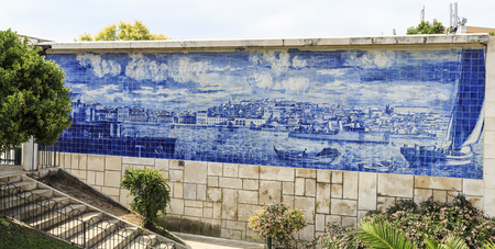 Historic tile panel in the lower garden of the belvedere of Santa Luzia showing a view of Lisbon from the Tagus River in early twentieth century Stock Photo