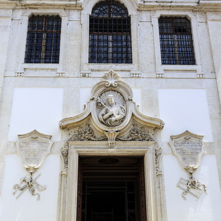 Medallion with the figure of St Joseph in high relief, flanked by two shields with symbols of carpenters on the right and masons on the left, in Lisbon, Portugal