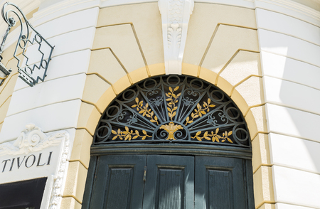 Detail of the semi-circular window on top of the entrance door of the neoclassical Tivoli Theater built in early 20th century in central Lisbon, Portugal