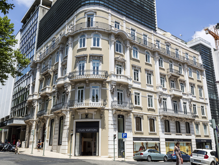 Residential building with a luxury Louis Vuitton store in the groundfloor built in neoclassical architecture in downtown Lisbon, Portugal