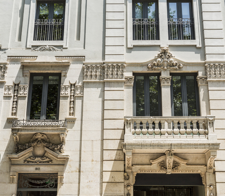 Detail of the neoclassical architectural elements on a facade of a building in downtown Lisbon, Portugal