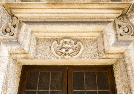 View of an elegant decorative architrave or epistyle on top of a door on an old building, in downtown Lisbon, Portugal Stock Photo