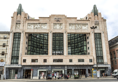 The Eden Theater is an iconic building built in early 20th century decorative art style, with pilasters crowned by masks, in Lisbon, Portugal