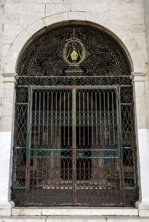 It is believed St Amaro healed broken legs and arms. In this gate of the 18th century, a bishop mitre is the main feature of the decoration. In Lisbon, Portugal Stock Photo