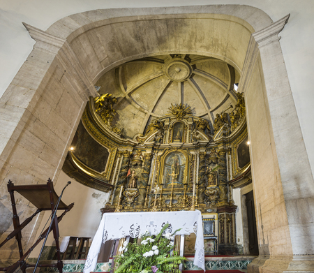 View of the gilded altarpiece in the main chapel of the Chapel of Saint Amaro where the main statue represents Saint Amaro as a bishop, in Alcantara, Lisbon, Portugal Editorial