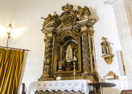 View of the gilded side altar in the Chapel of Saint Amaro honouring the Virgin Mary, in Alcantara, Lisbon, Portugal
