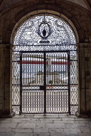 Outside view through the central wrought iron gate of the Renaissance Chapel of Saint Amaro in Lisbon, Portugal