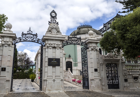 Main gate of the 5 star hotel occupying the sumptuous neoclassical Vale Flor Palace built in early 20th century in Lisbon, Portugal