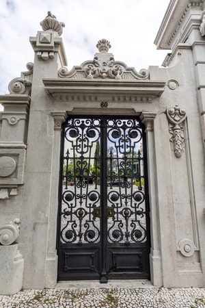Detail of the gate to the gardens of the sumptuous neoclassical Vale Flor Palace built in early 20th century in Lisbon, Portugal