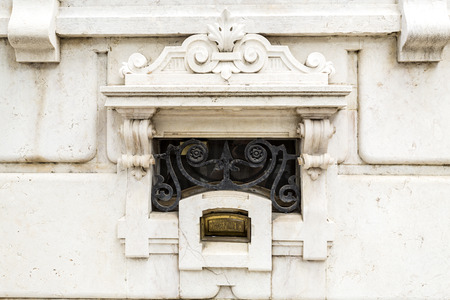 Detail of the brass letterbox of the sumptuous neoclassical Vale Flor Palace built in early 20th century in Lisbon, PortugalTrans: Letters