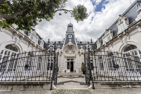 Facade of the horse stables in the same romantic style as the main Vale Flor Palace across the road, in Alcantara, Lisbon, Portugal Editorial