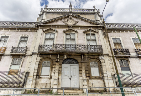 Monumental facade of the derelict Palace of Condes da Ribeira Grande, built in the early years of the 18th century in Alcantara, Lisbon, Portugal Editorial