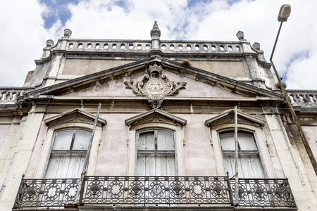 Detail of the monumental facade of the derelict Palace of Condes da Ribeira Grande, built in the early years of the 18th century in Alcantara, Lisbon, Portugal