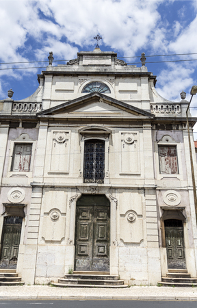 View of the tripartite facade of the Chapel of Our Lady of Carmo derelict Palace of Condes da Ribeira Grande, built in the early years of the 18th century in Alcantara, Lisbon, Portugal